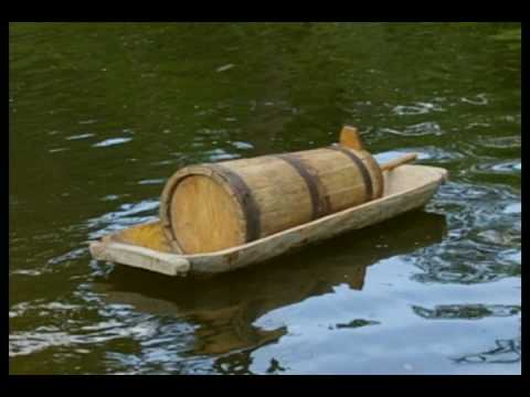 Antique primitive wooden butter churn and dough bowl going down the river to you