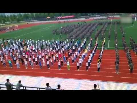 Thousands of military trainees dance to hit tracks