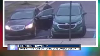 Clinton Township police looking for man wanted for scratching several cars in library parking lot