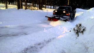 Dump truck plowing