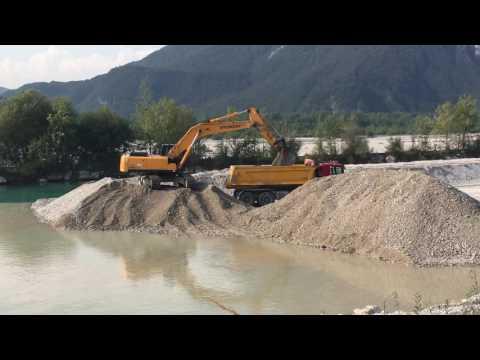 Hyundai 320NLC-7A Excavator Loading Iveco and Scania Trucks