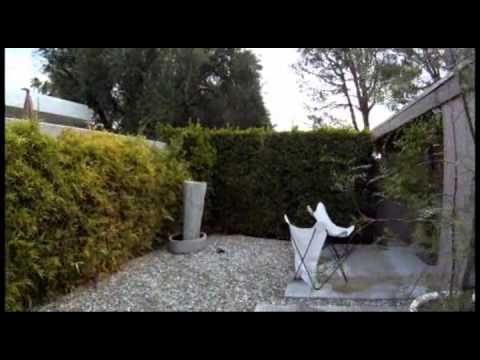 Flying camera tour of Palm Springs property exterior.