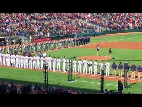 Dessa sings National Anthem. Bald eagle lands on player in left field.