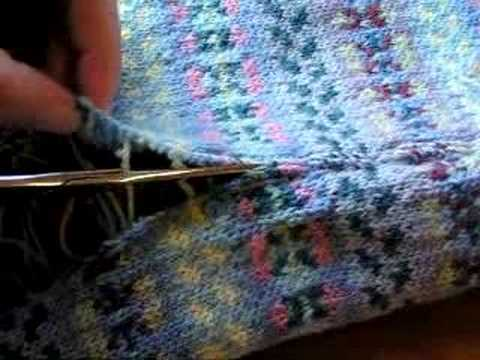 Cutting a steek, in a Knitted Fair Isle baby blanket - YouTube