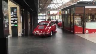 Beautiful red Porsche 356 Carrera 2 - a Lamborghini Countach is started in the background