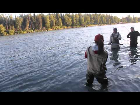 Charmaine fights with a Salmon at the Kenai River