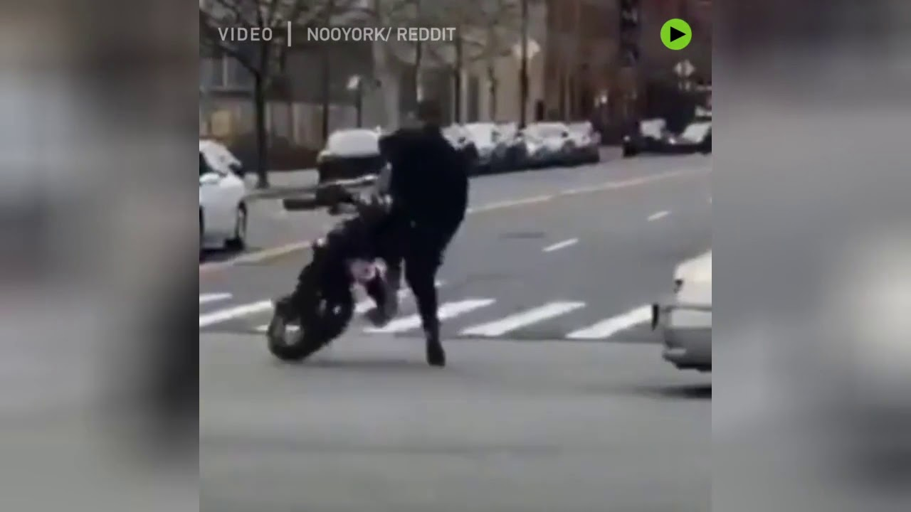Wheelie embarrassing: NYPD officer wipes out in spectacular dirt bike fail