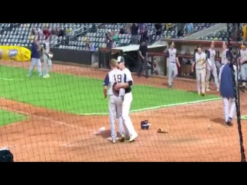 Baseball player hugs childhood friend on the losing team