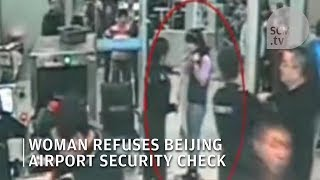 Chinese woman refuses security check at Beijing airport