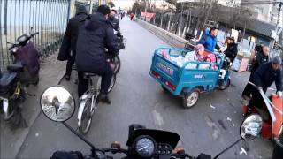 Riding a China made motorcycle in Beijing