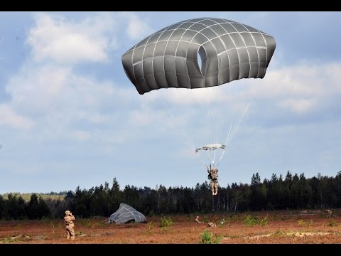 RAW: U.S. paratroopers jump into Latvia