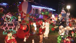 Albuquerque homeowners with flashy holiday lights collect clothes for the homeless