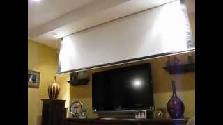 Projector screen in front of TV.