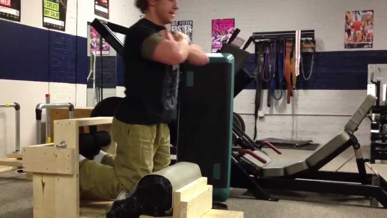 Homemade glute-ham raise (GHR) at work