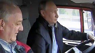 Putin drives truck across new Russia-Crimea bridge