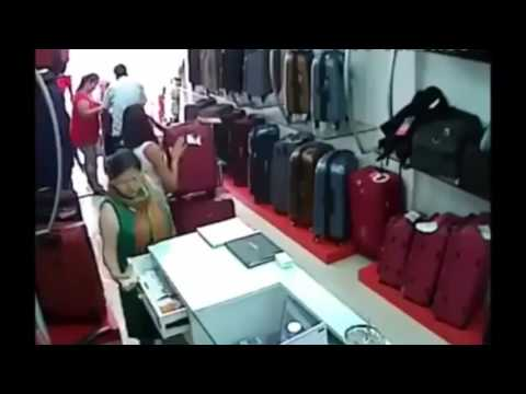 Girl Theft of Money in The Shop Caught on Camera CCTV