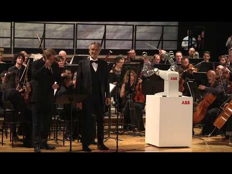 Yumi robot conducts opera with Andrea Bocelli and Lucca Symphony Orchestra