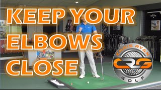 GOLF, KEEP YOUR ELBOWS CLOSER