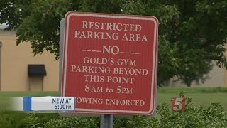 Armed Volunteer Has Illegally Parked Cars Towed From Business Parking Lot