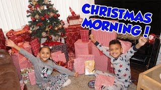 CHRISTMAS MORNING OPENING PRESENT!! BROTHER VS SISTER NERF CHALLENGE!!