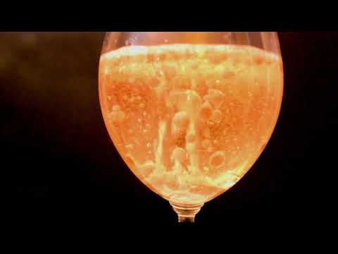 Satisfying colored oil in champagne glass