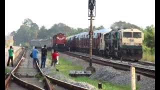 SUPER AGGRESSIVE SPEEDKING OF KONKAN RAILWAY OVERTAKES TWIN WDG4 FREIGHT AT 100KMPH!