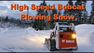 High Speed Bobcat Plowing Snow