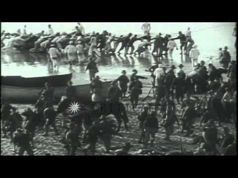 Soldiers board boats and advance during the Spanish American War in Cuba HD Stock Footage