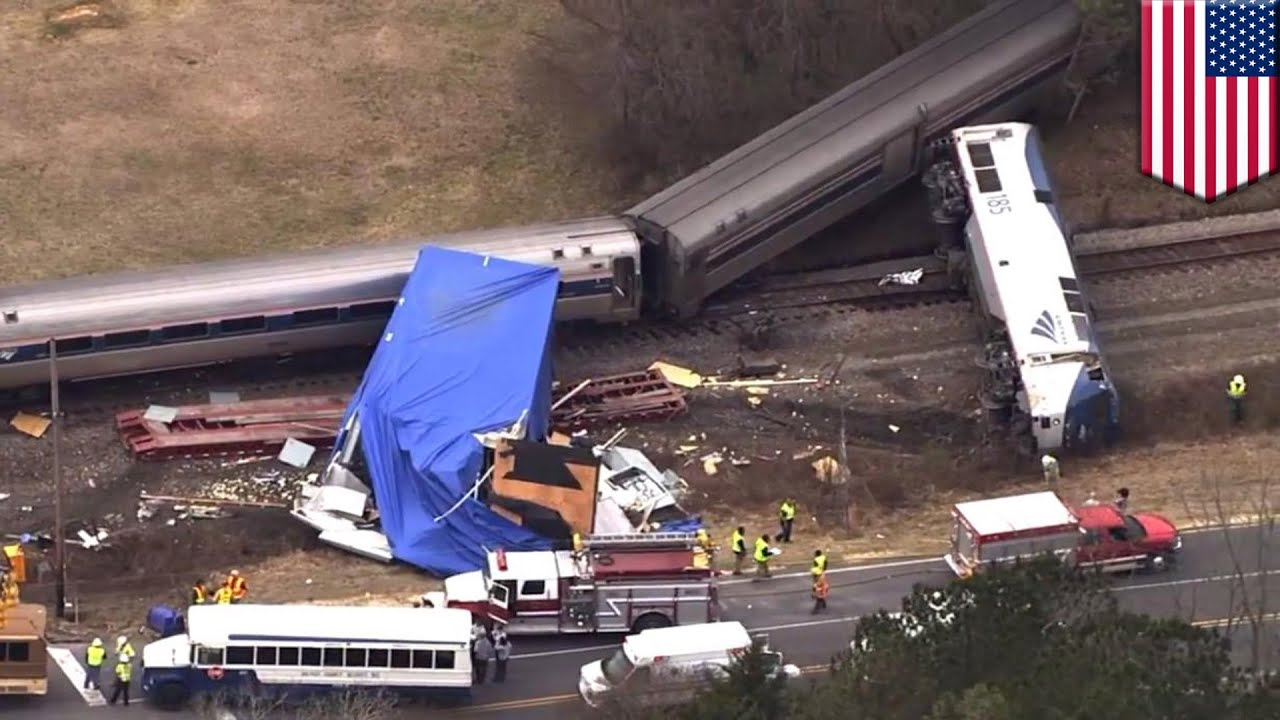 Amtrak train crash into tractor-trailer at railroad crossing caught on tape
