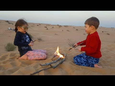 Thumbnail: Kids playing with sand in the desert. They pretend have slides, and do fire. Video 2017