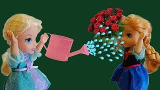 Elsa and Anna toddlers flowers and gardening