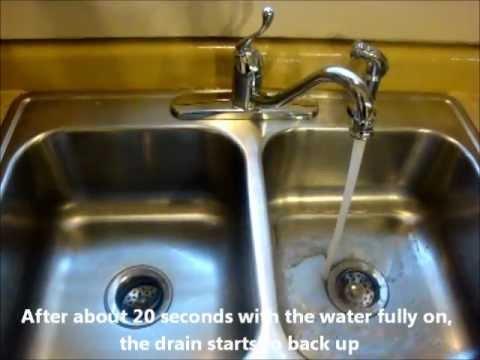impossibly slow kitchen sink drain