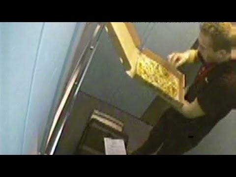 Pizza man eats toppings off one of his deliveries