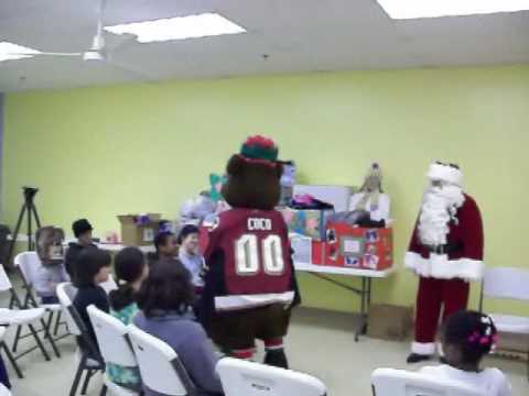 Santa, Cocoa and Hershey Bears Hocky Team visits LCCM with gifts.wmv