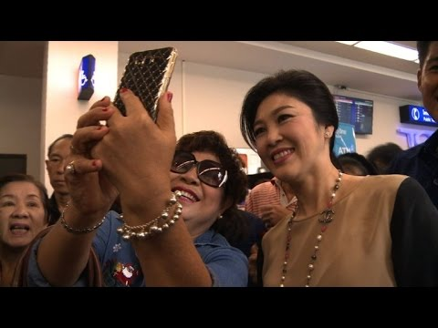 Thai ex-PM Yingluck defies army with selfie and smiles tour