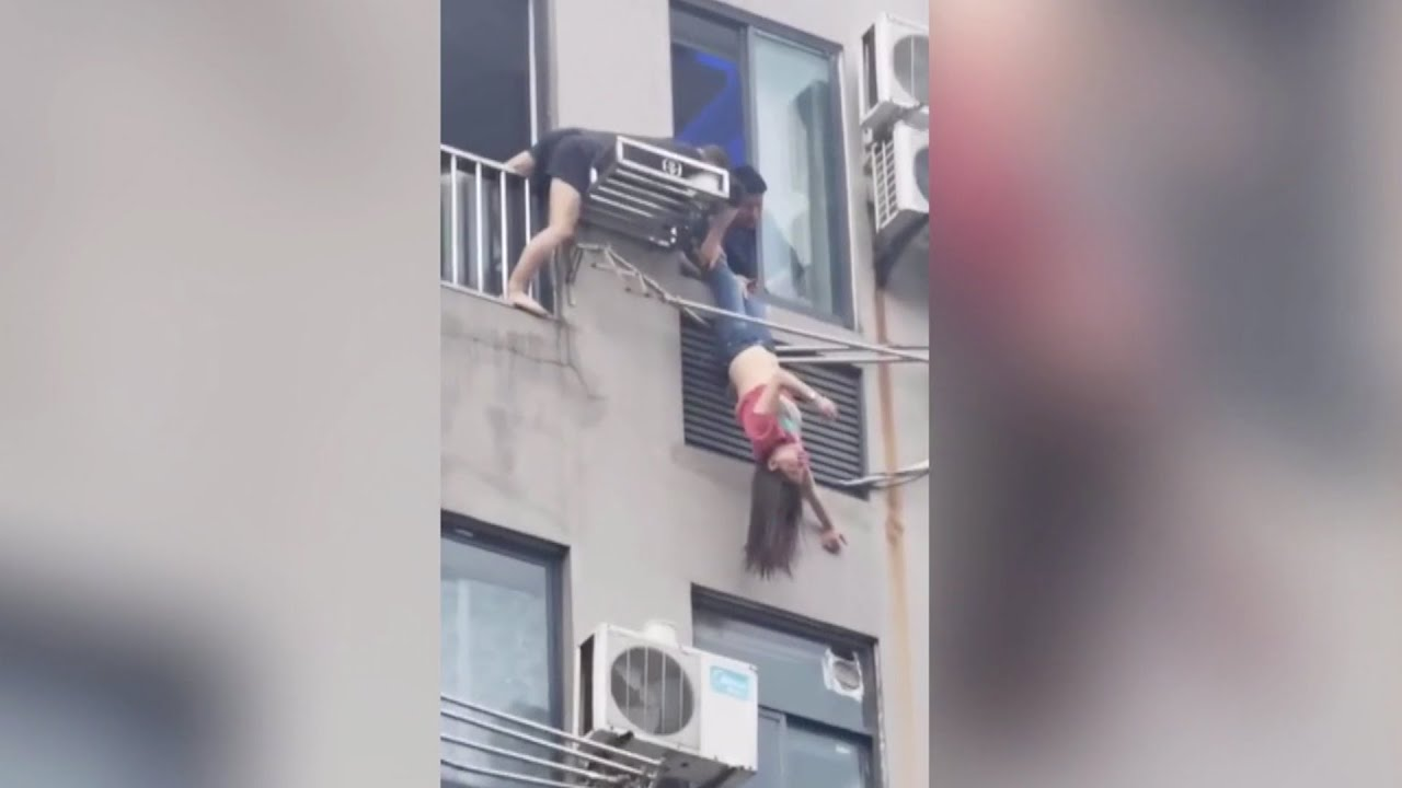 Neighbor rescues woman hanging upside down from 7th floor in China