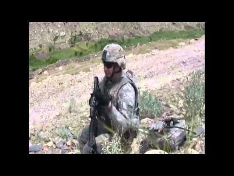 Specialist Mark D Talks to Bob Calvert in Afghanistan