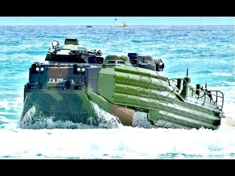 US Military Amphibious Military Vehicles conduct beach landing