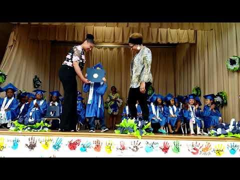 Judith p hoyer montessori- Kai receiving Kindergarten diploma