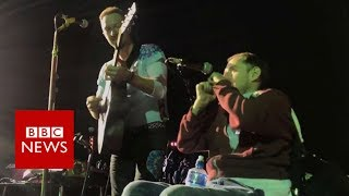 Disabled fan's on-stage performance with Coldplay - BBC News