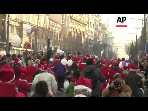 Thousands dress up as Santa for annual charity run through capital