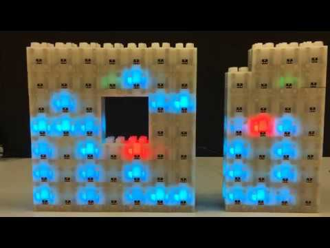 A distributed and extensible bitmap scroller made from Blinky Blocks