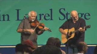 Cajun fiddler Michael Doucet performs with David Doucet and Mitchell Reed
