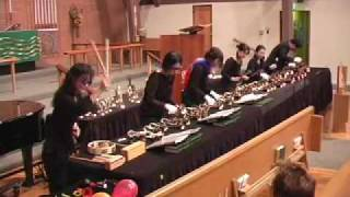 Kiriku playing Plink, Plank, Plunk by Leroy Andersen on Handbells