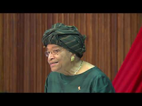 PRESIDENT ELLEN JOHNSON SIRLEAF HONORS OLUSEGUN OBANSANJO FORMER NIGERIA PRESIDENT IN LIBERIA
