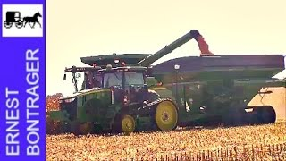 Two John Deere S680 Combines with 12 Row Corn Heads