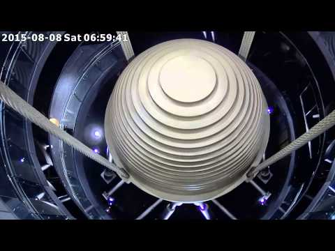 What you are seeing is a 720 ton steel ball, suspended in a chamber between floors 87 and 92 of Taipei 101. It's swinging to counteract the swaying of the building during a recent typhoon