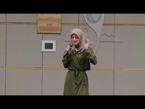 Amal Kassir speaking to APS Leaders