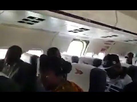 Aircraft door falls off as terrified pa ssengers watch on