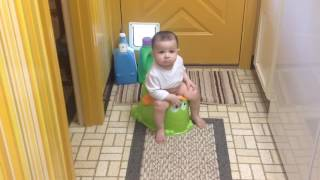 8 months old boy using potty